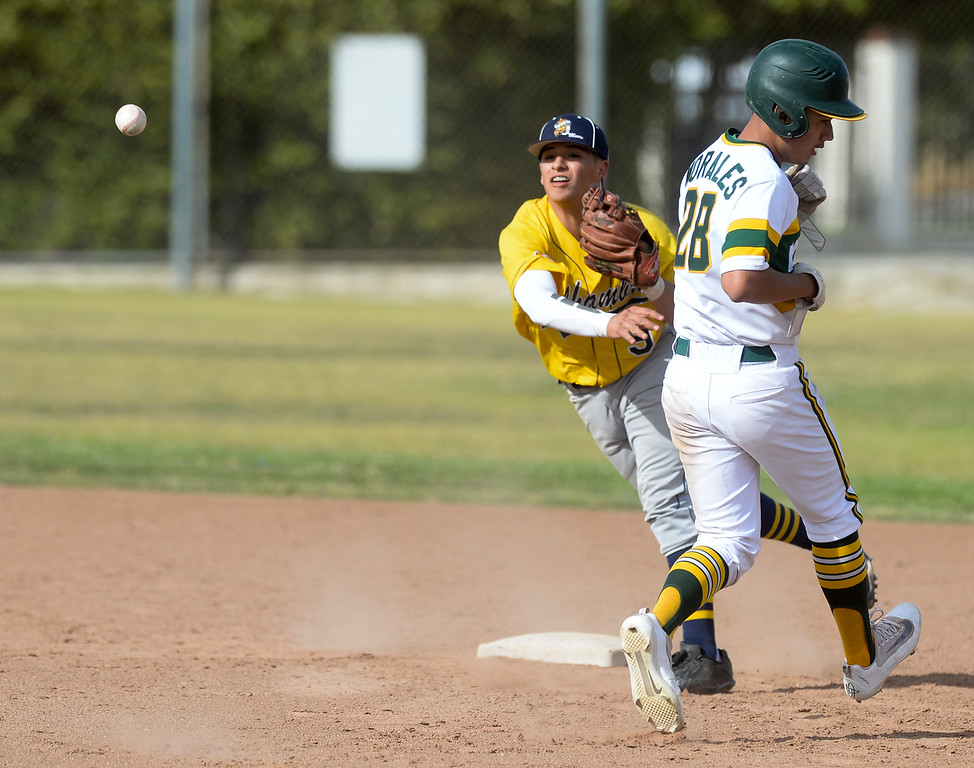 . Alhambra shortstop Jake Sanchez (9) forces out Schurr\'s Gabriel Morales (28) and throws to complete the double play in their Almont League baseball game at Schurr High School in Montebello on Tuesday April 25, 2017. (Photo by Keith Durflinger/Whittier Daily News/SCNG)