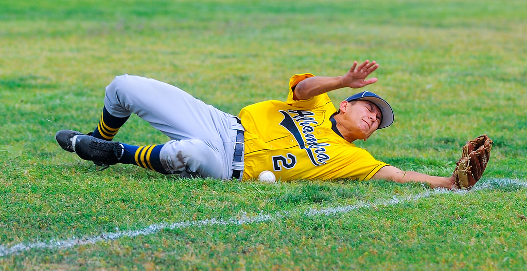 . Alhambra\'s Joseph Ramirez (2) lunges for but misses a fly ball as the play Schurr in their Almont League baseball game at Schurr High School in Montebello on Tuesday April 25, 2017. (Photo by Keith Durflinger/Whittier Daily News/SCNG)