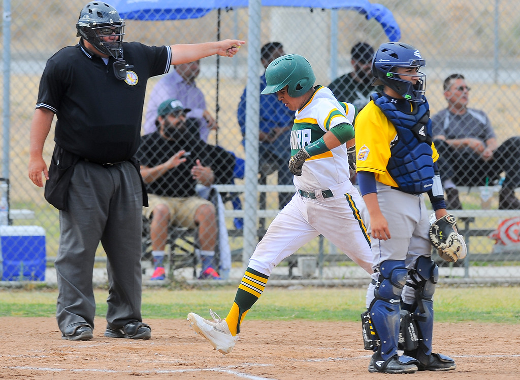 . Schurr\'s Justin Cervantes (42) scores aa they play Alhambra in their Almont League baseball game at Schurr High School in Montebello on Tuesday April 25, 2017. (Photo by Keith Durflinger/Whittier Daily News/SCNG)