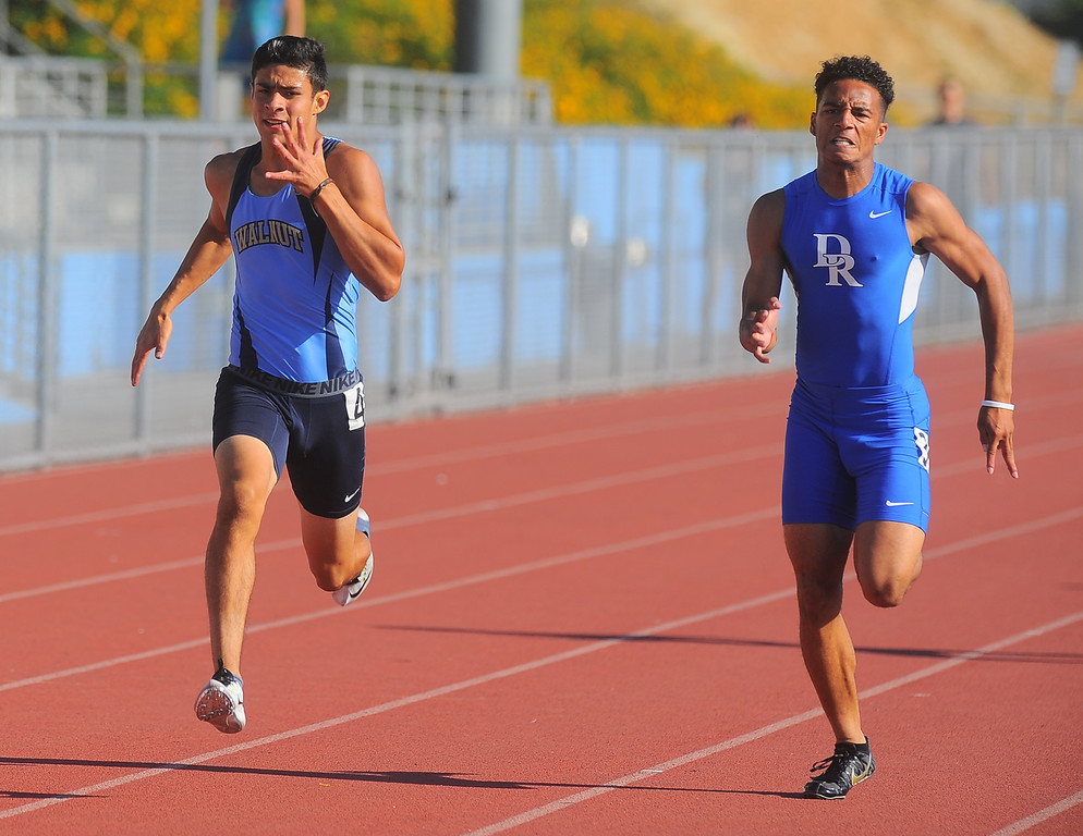 . Walnut\'s Jared Arellano, left, finishes first in the Boys Varsity 200 Meter Dash in the Hacienda League track finals at Walnut High School in Walnut on Thursday May 4, 2017. (Photo by Keith Durflinger/Whittier Daily News/SCNG)