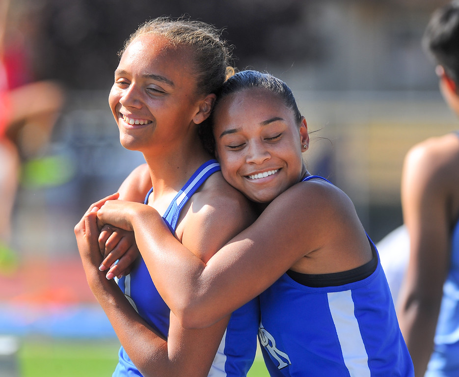 . Diamond Ranch\'s Kennedy Lindsey, left, and Brita Liggins embrace after competing in the Girls Varsity 400 Meter Run in the Hacienda League track finals at Walnut High School in Walnut on Thursday May 4, 2017. (Photo by Keith Durflinger/Whittier Daily News/SCNG)