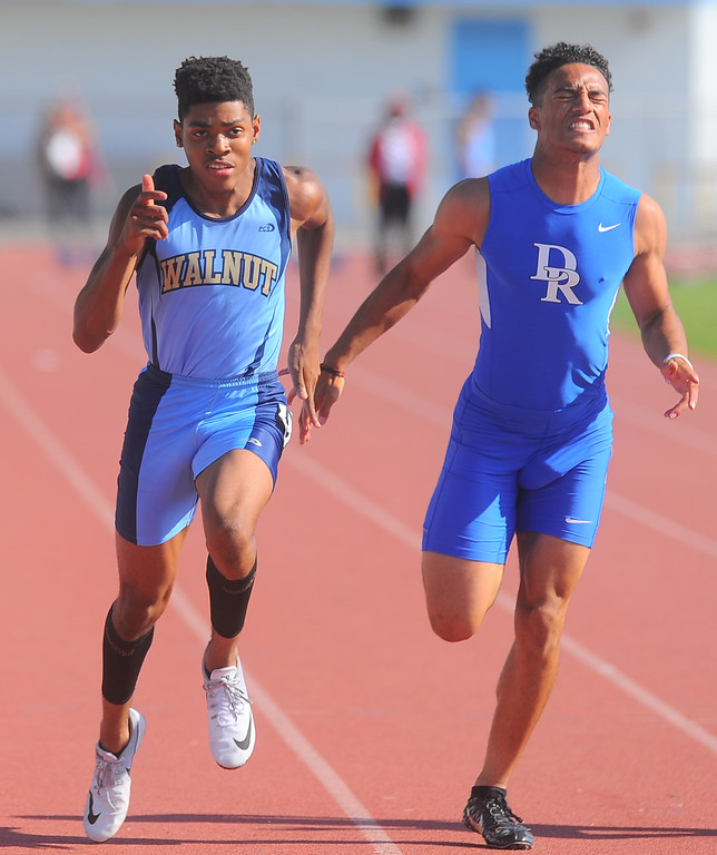 . Walnut\'s Ryan Hines, left, finishes first in the Boys Varsity 100 Meter Dash in the Hacienda League track finals at Walnut High School in Walnut on Thursday May 4, 2017. (Photo by Keith Durflinger/Whittier Daily News/SCNG)