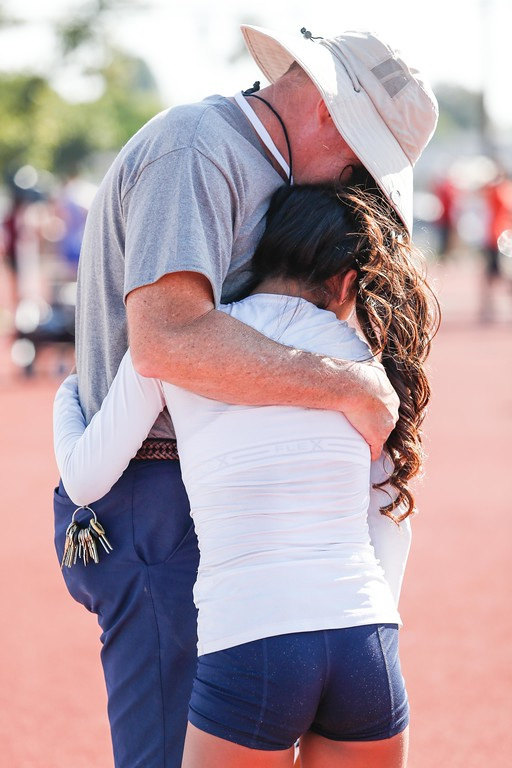 ". Fernanda Ponce of Cal High is consoled by her coach after failing to clear 4\'9"". Ponce ended up in second place at the Del Rio League Track Finals Thursday May 4, 2017 at Cal High. (Correspondent photo by Chris Burt/Sports: To purchase these pictures contact the photographer directly clburt@verizon.net )"