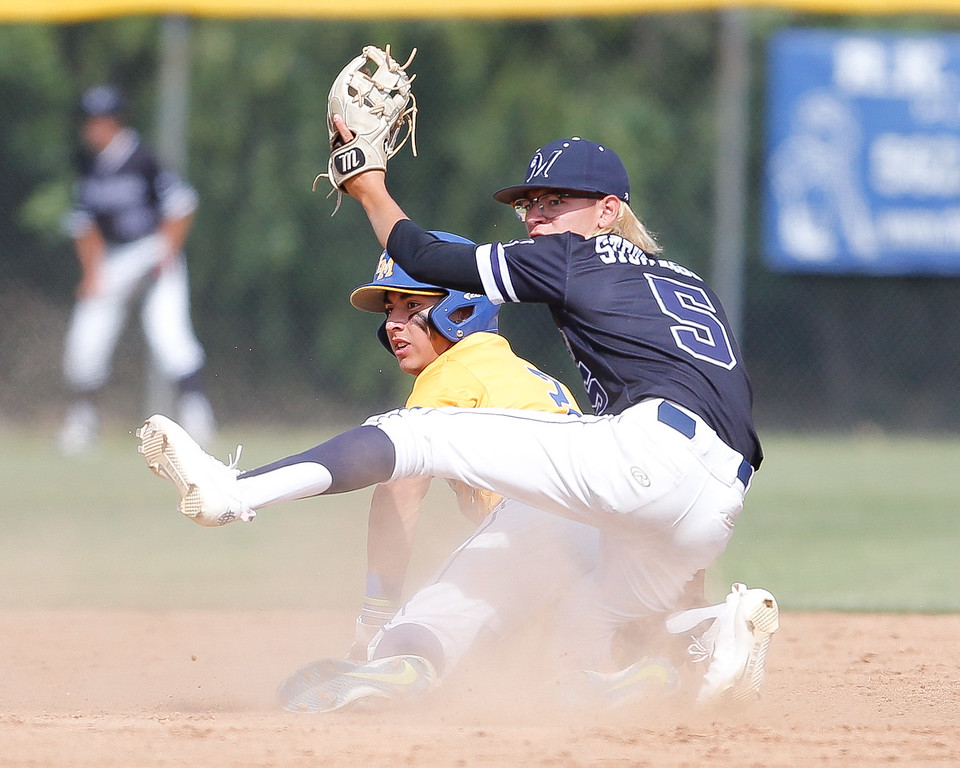 . Alex Gonzalez of La Mirada slides under the tag of Dennis Stevenson of Mayfair. La Mirada went on to defeat Mayfair 3-2 in the Suburban League matchup Friday, May 05, 2017 at La Mirada. (Correspondent photo by Chris Burt/Sports: To purchase these pictures contact the photographer directly clburt@verizon.net )