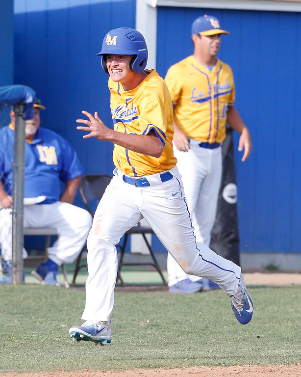 . Zane Palermo of La Mirada rounds 3rd in the bottom of the 7th to break a 2-2 tie against the Mayfair Monsoons Friday May 5, 2017 at La Mirada.. The win will give the Matadores sole possession of 1st place in the Suburban League. (Correspondent photo by Chris Burt/Sports: To purchase these pictures contact the photographer directly clburt@verizon.net )