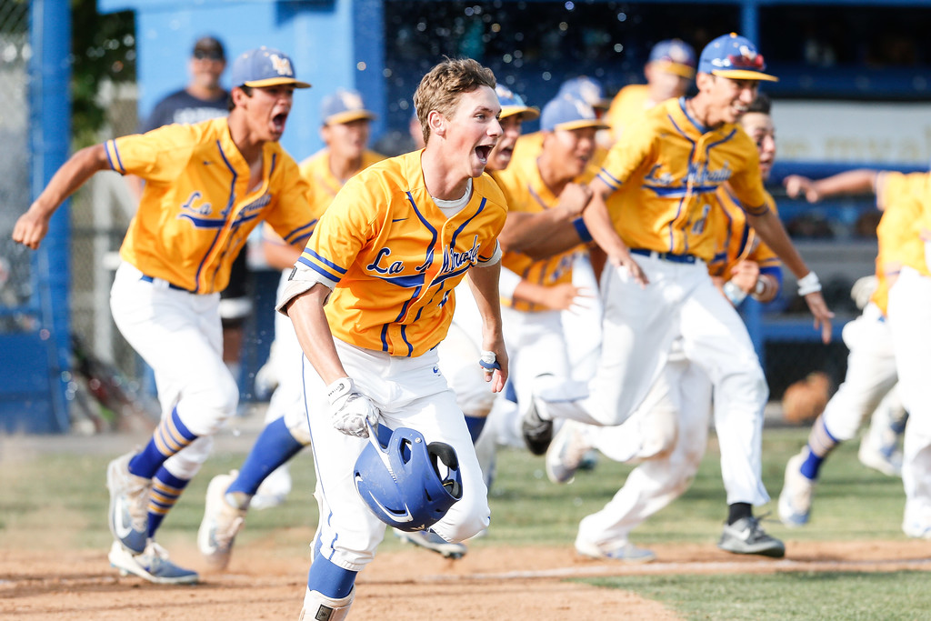. La Mirada�s baseball team runs out on the field to celebrate a 3-2 win over the Mayfair Monsoons Friday, May 05, 2017 at La Mirada. (Correspondent photo by Chris Burt/Sports: To purchase these pictures contact the photographer directly clburt@verizon.net )