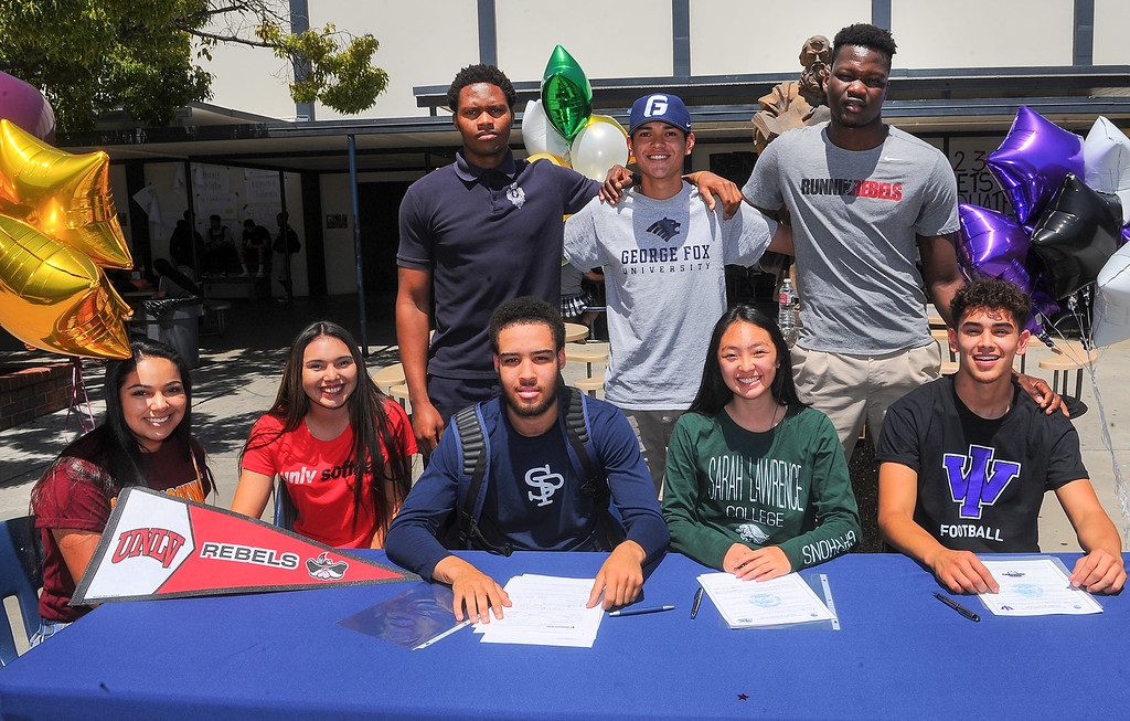 . Student athletes, from front left, Alexis Bermudez, Jaclyn Candelas, Kylan Mann, Kaylin Yamada and Cody Cardenas, back left, Elie Ghomsi, Nehemiah Rodriguez and Louis Bangai after signing their Letters of Intent to play their sport in Universities during a lunchtime ceremony at St. Paul High School in Santa Fe Springs on Friday May 19, 2017. (Photo by Keith Durflinger/Whittier Daily News/SCNG)