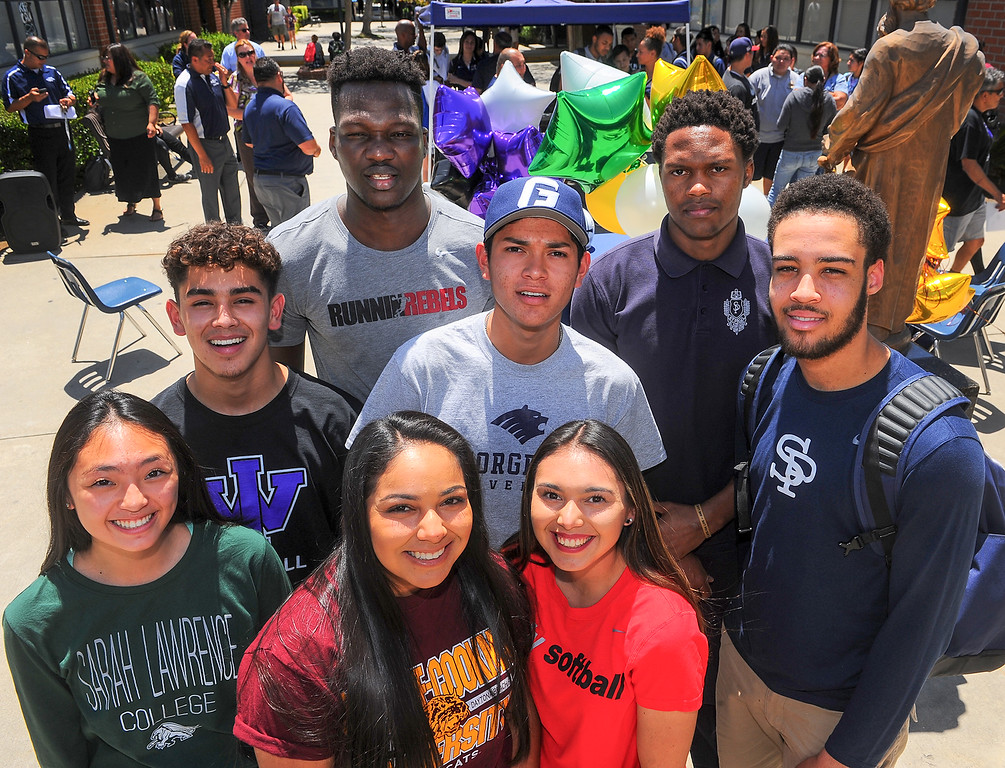 . Student athletes, from front left, Kaylin Yamada, Alexis Bermudez, Jaclyn Candelas, back left, Cody Cardenas, Louis Bangai, Nehemiah Rodriguez, Elie Ghomsi and Kylan Mann have signed their Letters of Intent to play their sport in Universities during a lunchtime ceremony at St. Paul High School in Santa Fe Springs on Friday May 19, 2017. (Photo by Keith Durflinger/Whittier Daily News/SCNG)