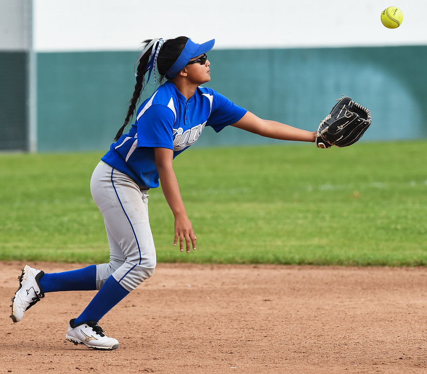 . El Monte High Melanie Melendez as shortstop, stops a ground ball of her leg that bounces upwards. Monrovia High School girls softball team won the game 4-1 against  El Monte High School at Monrovia Tuesday, May 19, 2015.(Photo by Walt Mancini/Pasadena Star-News)