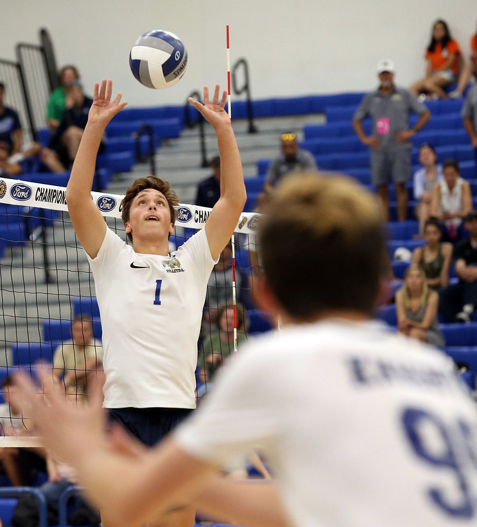 . Notre Dame\'s Christopher Hall (1), top, sets the ball as Garrett Cane (99), bottom, gets in position to hit during Saturday\'s CIF-SS Division 2 Boys Volleyball Final between Calabasas and Notre Dame at Cerritos College in Norwalk, CA Saturday, May 20, 2017. (Photo by Mark Dustin for the Los Angeles Daily News/SCNG)