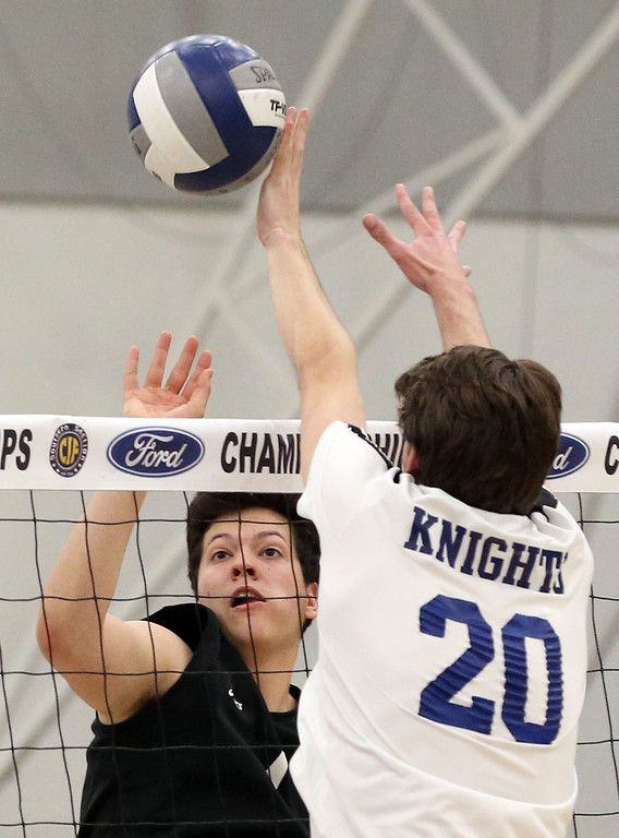 . Calabasas\' Harrison Franz (1), left, tips the ball by the block of Notre Dame\'s Brendon Dunn (20), right, during Saturday\'s CIF-SS Division 2 Boys Volleyball Final between Calabasas and Notre Dame at Cerritos College in Norwalk, CA Saturday, May 20, 2017. (Photo by Mark Dustin for the Los Angeles Daily News/SCNG)