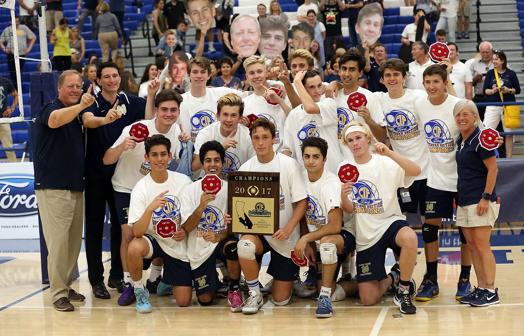 . Notre Dame poses for photos with the champioship plaque after defeating Calabasas in Saturday\'s CIF-SS Division 2 Boys Volleyball Final between Calabasas and Notre Dame at Cerritos College in Norwalk, CA Saturday, May 20, 2017. (Photo by Mark Dustin for the Los Angeles Daily News/SCNG)