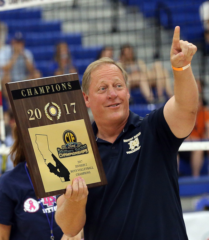 . Notre Dame Head Coach Jim Hall points to the crowd after receiving the championship plaque after defeating Calabasas in  Saturday\'s CIF-SS Division 2 Boys Volleyball Final between Calabasas and Notre Dame at Cerritos College in Norwalk, CA Saturday, May 20, 2017. (Photo by Mark Dustin for the Los Angeles Daily News/SCNG)