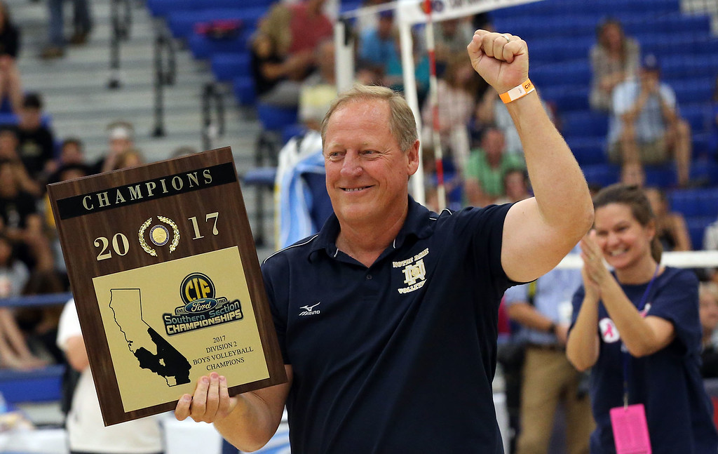 . Notre Dame Head Coach Jim Hall pumps his fist after receiving the championship plaque after defeating Calabasas in  Saturday\'s CIF-SS Division 2 Boys Volleyball Final between Calabasas and Notre Dame at Cerritos College in Norwalk, CA Saturday, May 20, 2017. (Photo by Mark Dustin for the Los Angeles Daily News/SCNG)