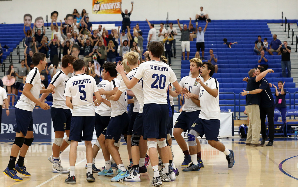 . Notre Dame players celebrate on the court after defeating Calabasas in Saturday\'s CIF-SS Division 2 Boys Volleyball Final between Calabasas and Notre Dame at Cerritos College in Norwalk, CA Saturday, May 20, 2017. (Photo by Mark Dustin for the Los Angeles Daily News/SCNG)