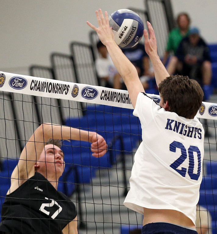 . Calabasas\' Shane Egerstrom (27), left, hits a shot by Notre Dame\'s Brendon Dunn (20), right, during Saturday\'s CIF-SS Division 2 Boys Volleyball Final between Calabasas and Notre Dame at Cerritos College in Norwalk, CA Saturday, May 20, 2017. (Photo by Mark Dustin for the Los Angeles Daily News/SCNG)
