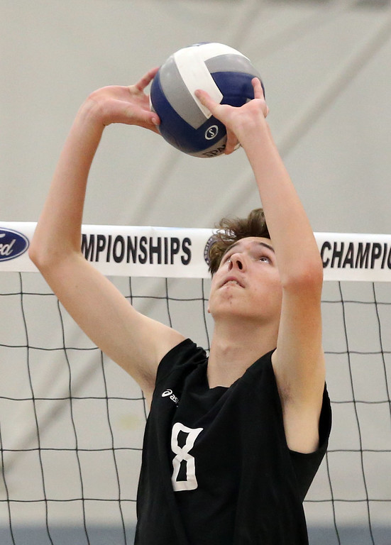 . Calabasas\' Brendin Chandler (8) sets the ball during Saturday\'s CIF-SS Division 2 Boys Volleyball Final between Calabasas and Notre Dame at Cerritos College in Norwalk, CA Saturday, May 20, 2017. (Photo by Mark Dustin for the Los Angeles Daily News/SCNG)