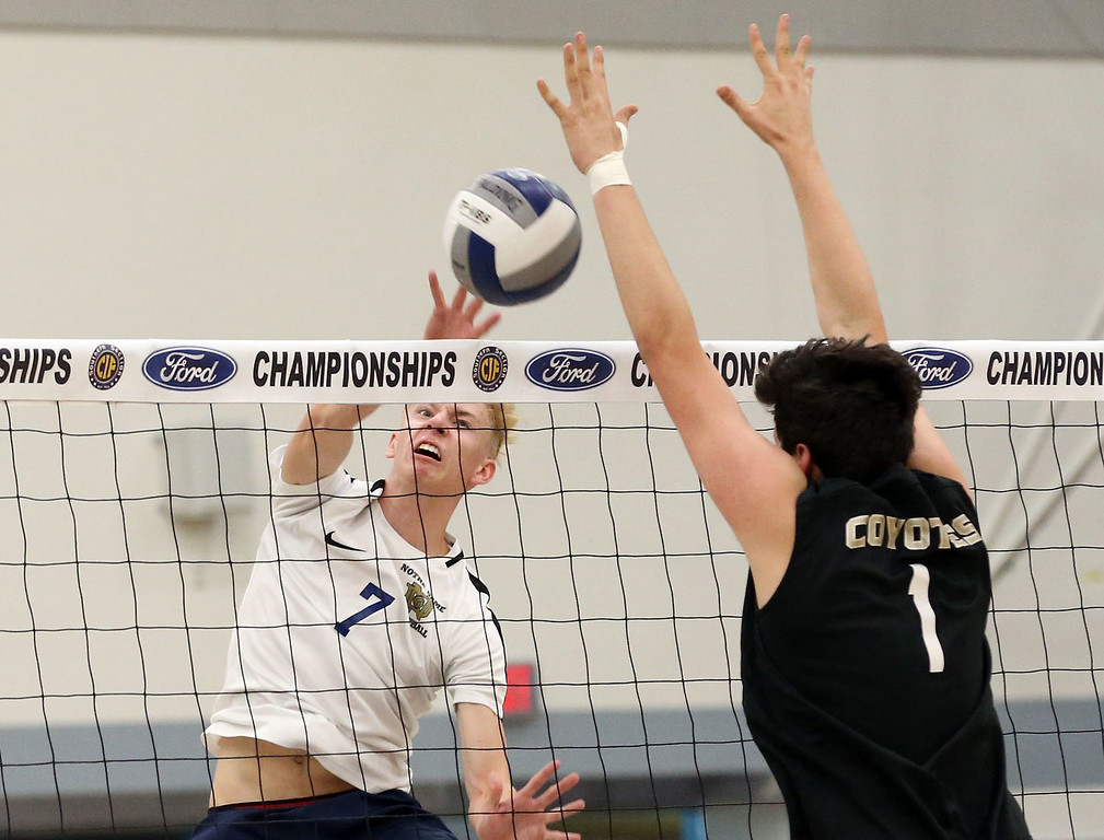 . Notre Dame\'s Sean Auten (7), left, hits the ball by the block of Calabasas\' Harrison Franz (1), right, during Saturday\'s CIF-SS Division 2 Boys Volleyball Final between Calabasas and Notre Dame at Cerritos College in Norwalk, CA Saturday, May 20, 2017. (Photo by Mark Dustin for the Los Angeles Daily News/SCNG)