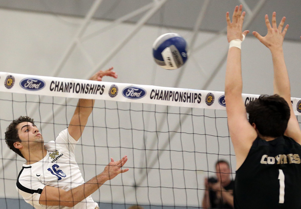 . Notre Dame\'s Cory Safady (16), left, hits against the block of Calabasas\' Harrison Franz (1), right, during Saturday\'s CIF-SS Division 2 Boys Volleyball Final between Calabasas and Notre Dame at Cerritos College in Norwalk, CA Saturday, May 20, 2017. (Photo by Mark Dustin for the Los Angeles Daily News/SCNG)