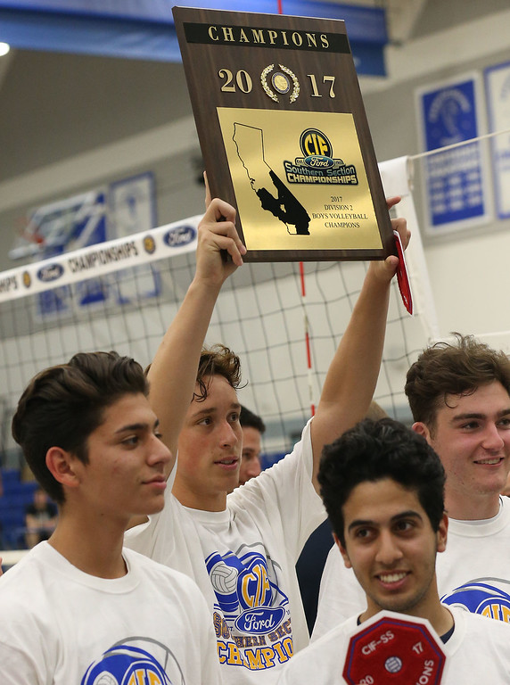 . Notre Dame\'s Christopher Hall (1), center, raises the championship plaque after defeating Calabasas in  Saturday\'s CIF-SS Division 2 Boys Volleyball Final between Calabasas and Notre Dame at Cerritos College in Norwalk, CA Saturday, May 20, 2017. (Photo by Mark Dustin for the Los Angeles Daily News/SCNG)
