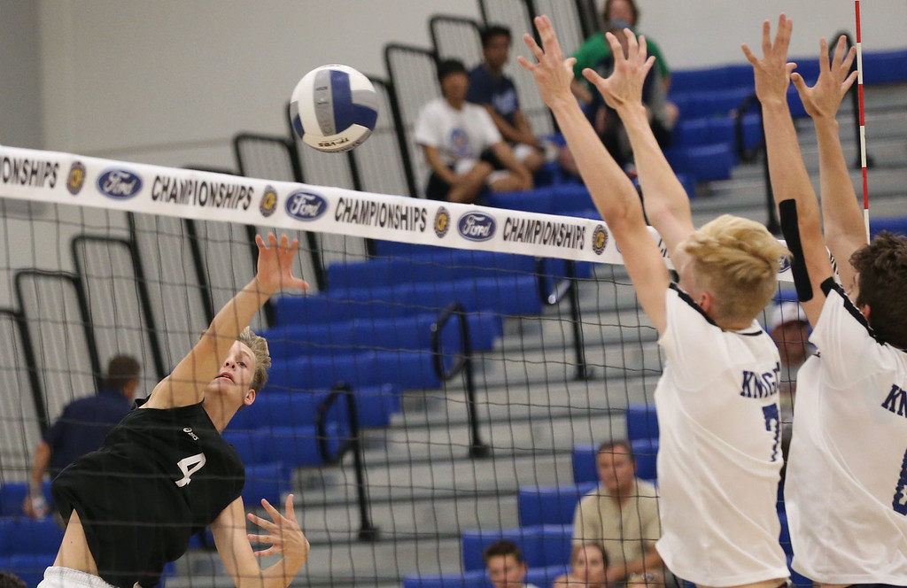. Calabasas\' Matthew Fulton (4), left, hits a shot by the double block of Notre Dame\'s Sean Auten (7), center, and Colin Fraser (6), right, during Saturday\'s CIF-SS Division 2 Boys Volleyball Final between Calabasas and Notre Dame at Cerritos College in Norwalk, CA Saturday, May 20, 2017. (Photo by Mark Dustin for the Los Angeles Daily News/SCNG)
