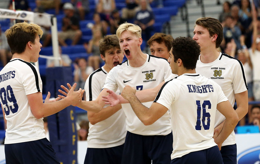 . Notre Dame\'s Sean Auten (7), center, and his teammates react after winning a point during Saturday\'s CIF-SS Division 2 Boys Volleyball Final between Calabasas and Notre Dame at Cerritos College in Norwalk, CA Saturday, May 20, 2017. (Photo by Mark Dustin for the Los Angeles Daily News/SCNG)