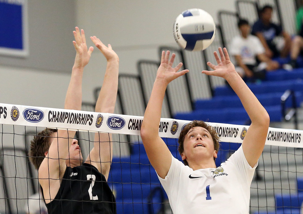 . Notre Dame\'s Christopher Hall (1), right, sets the ball at the net as Calabasas\' Joshua Strick (2), left, blocks against the dump shot during Saturday\'s CIF-SS Division 2 Boys Volleyball Final between Calabasas and Notre Dame at Cerritos College in Norwalk, CA Saturday, May 20, 2017. (Photo by Mark Dustin for the Los Angeles Daily News/SCNG)