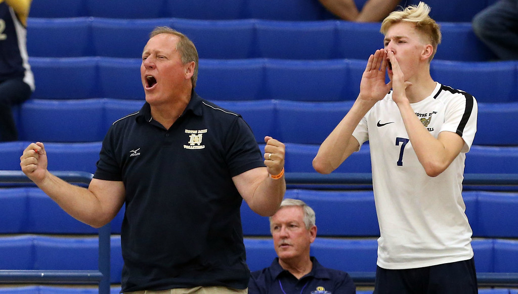 . Notre Dame Head Coach Jim Hall, left, reacts after a point as Sean Auten (7), right, cheers for his teammates during Saturday\'s CIF-SS Division 2 Boys Volleyball Final between Calabasas and Notre Dame at Cerritos College in Norwalk, CA Saturday, May 20, 2017. (Photo by Mark Dustin for the Los Angeles Daily News/SCNG)