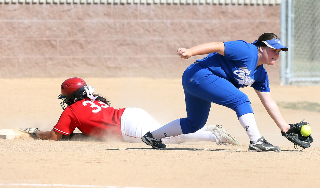 . Whittier\'s Amanda Canizales (33), left, slides safely into third base as Beaumont\'s Savannah Flinn (99), right, fields the late throw during Tuesday afternoon\'s CIF-SS Division 4 softball second-round playoff game between Beaumont High School and Whittier High School at Beaumont High School in Cherry Valley, CA Tuesday, May 23, 2017. (Photo by Mark Dustin for the Press Enterprise/SCNG)