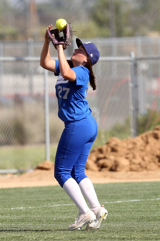 . Beaumont\'s Megan Watkins (27) catches a fly ball in short left field during Tuesday afternoon\'s CIF-SS Division 4 softball second-round playoff game between Beaumont High School and Whittier High School at Beaumont High School in Cherry Valley, CA Tuesday, May 23, 2017. (Photo by Mark Dustin for the Press Enterprise/SCNG)