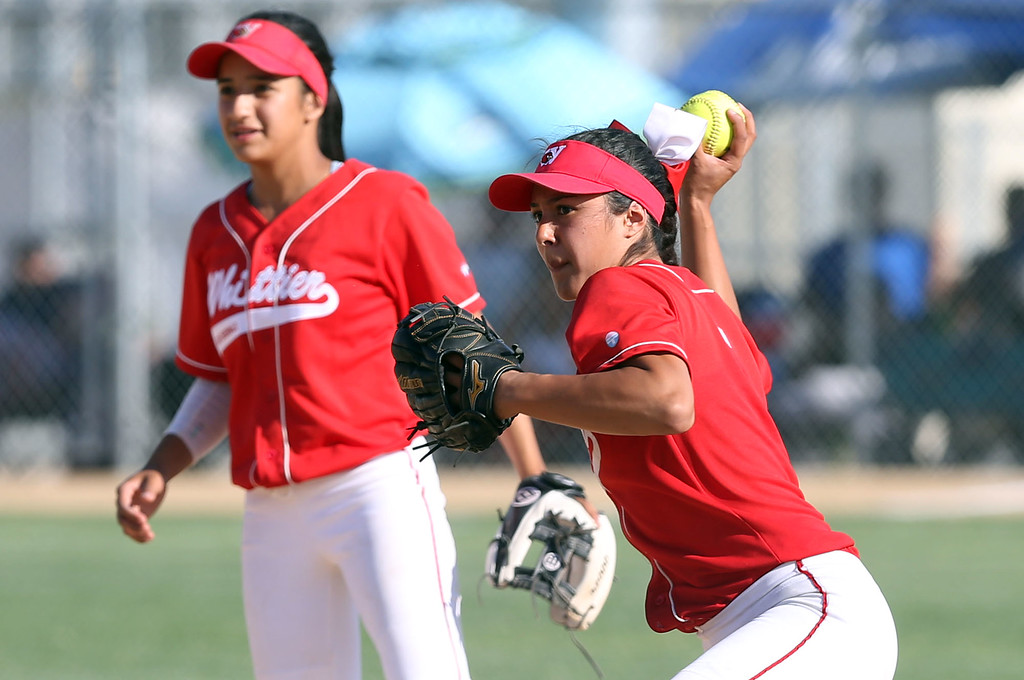 . Whittier\'s Jade Sanchez (5), right, looks to throw to first base as Serena Ortega (11), left, looks on during Tuesday afternoon\'s CIF-SS Division 4 softball second-round playoff game between Beaumont High School and Whittier High School at Beaumont High School in Cherry Valley, CA Tuesday, May 23, 2017. (Photo by Mark Dustin for the Press Enterprise/SCNG)