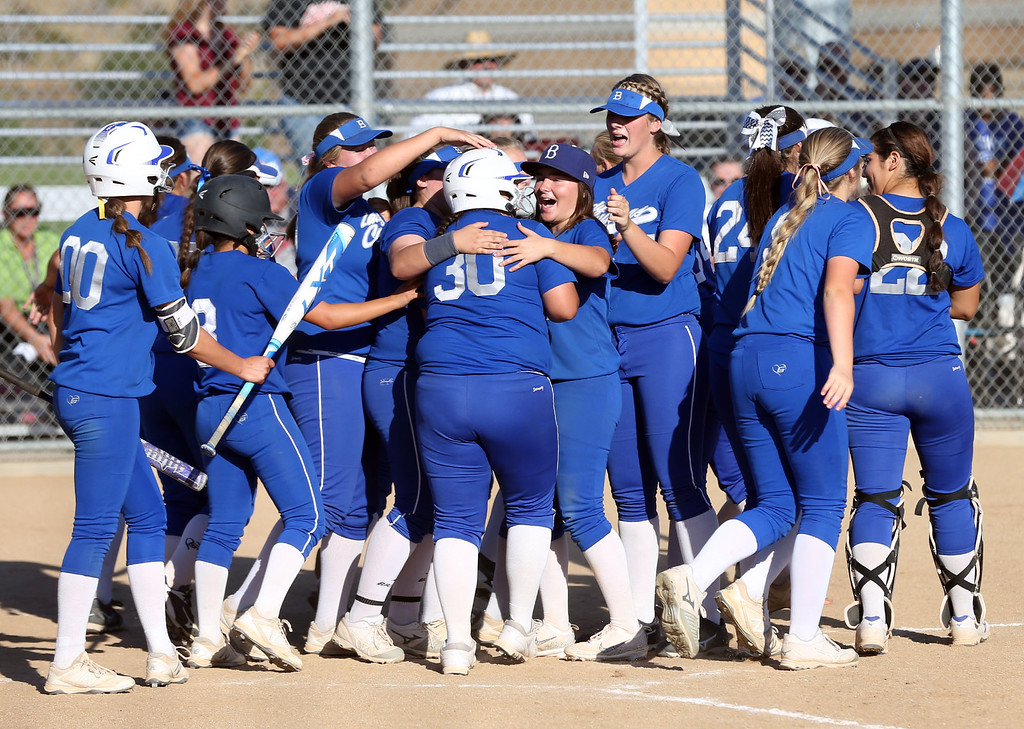 . Beaumont players gather at home plate to congratulate Alyssa Mays (30), center, after hitting home run during Tuesday afternoon\'s CIF-SS Division 4 softball second-round playoff game between Beaumont High School and Whittier High School at Beaumont High School in Cherry Valley, CA Tuesday, May 23, 2017. (Photo by Mark Dustin for the Press Enterprise/SCNG)
