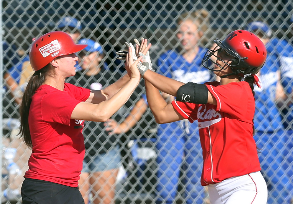 . Whittier Third Base Coach Liza Ledesma, left, congratulates Jade Sanchez (5), right, as she rounds third after hitting a home run during Tuesday afternoon\'s CIF-SS Division 4 softball second-round playoff game between Beaumont High School and Whittier High School at Beaumont High School in Cherry Valley, CA Tuesday, May 23, 2017. (Photo by Mark Dustin for the Press Enterprise/SCNG)