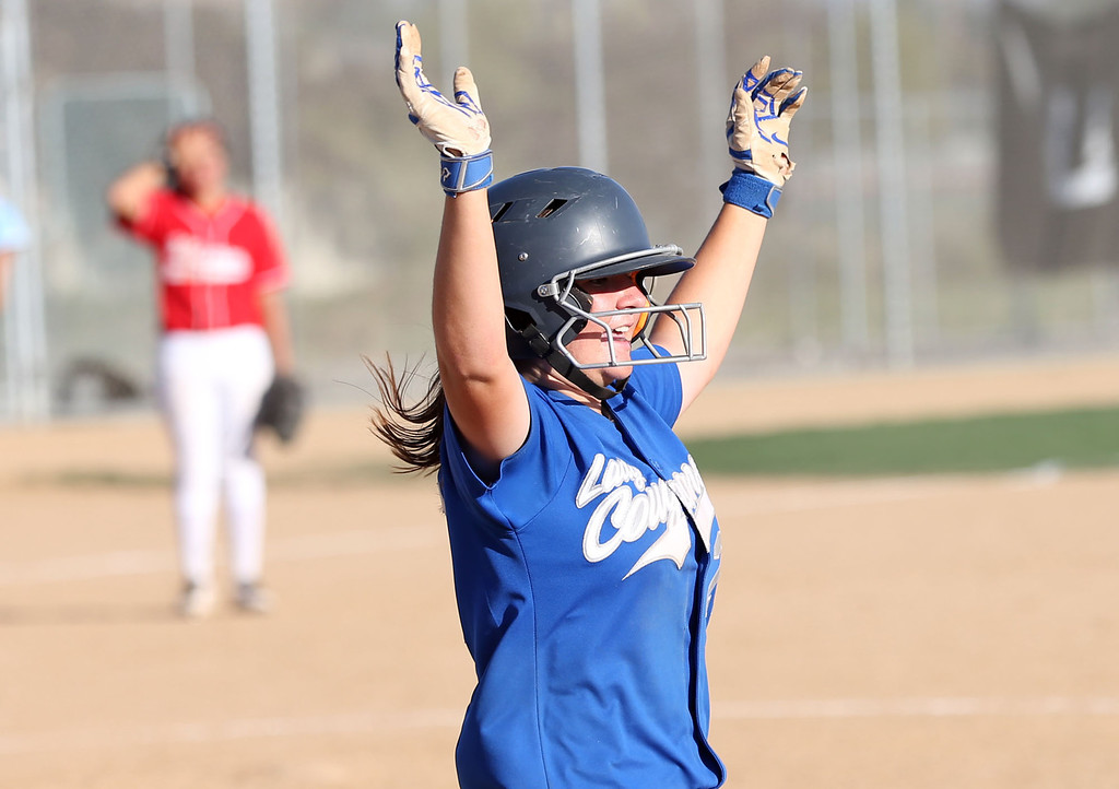 . Beaumont\'s Megan Watkins (27) raises her arms as she runs to first after driving in the winning run in the bottom of the seventh inning during Tuesday afternoon\'s CIF-SS Division 4 softball second-round playoff game between Beaumont High School and Whittier High School at Beaumont High School in Cherry Valley, CA Tuesday, May 23, 2017. (Photo by Mark Dustin for the Press Enterprise/SCNG)