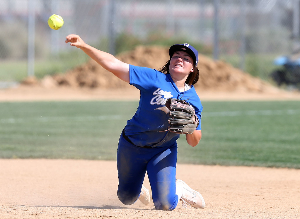 . Beaumont\'s Megan Watkins (27) tries to throw out a runner at first base during Tuesday afternoon\'s CIF-SS Division 4 softball second-round playoff game between Beaumont High School and Whittier High School at Beaumont High School in Cherry Valley, CA Tuesday, May 23, 2017. (Photo by Mark Dustin for the Press Enterprise/SCNG)