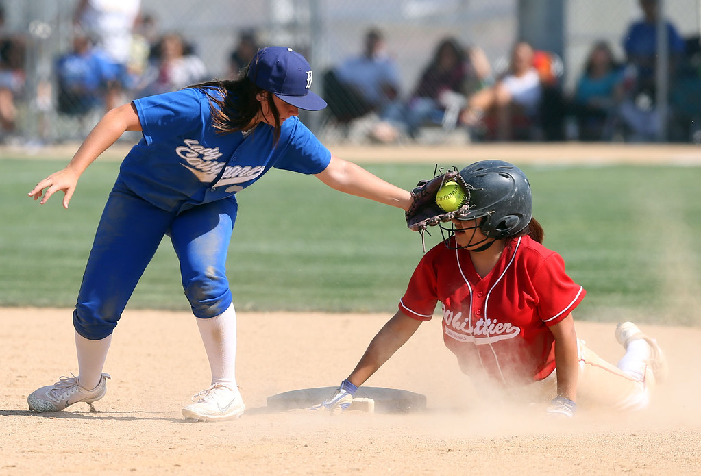 . Beaumont\'s Megan Watkins (27), left, keeps the tag on Whittier\'s Monique Amaro (22), right, after sliding safely into second base during Tuesday afternoon\'s CIF-SS Division 4 softball second-round playoff game between Beaumont High School and Whittier High School at Beaumont High School in Cherry Valley, CA Tuesday, May 23, 2017. (Photo by Mark Dustin for the Press Enterprise/SCNG)