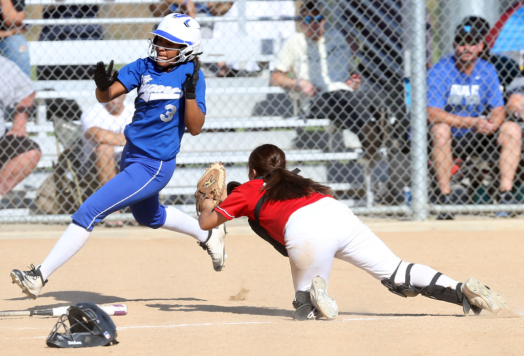 . Beaumont\'s Mahkenzy Lewis (3), left, dodges the diving tag attempt of Whittier\'s Monique Amaro (22), right, to score a run during Tuesday afternoon\'s CIF-SS Division 4 softball second-round playoff game between Beaumont High School and Whittier High School at Beaumont High School in Cherry Valley, CA Tuesday, May 23, 2017. (Photo by Mark Dustin for the Press Enterprise/SCNG)
