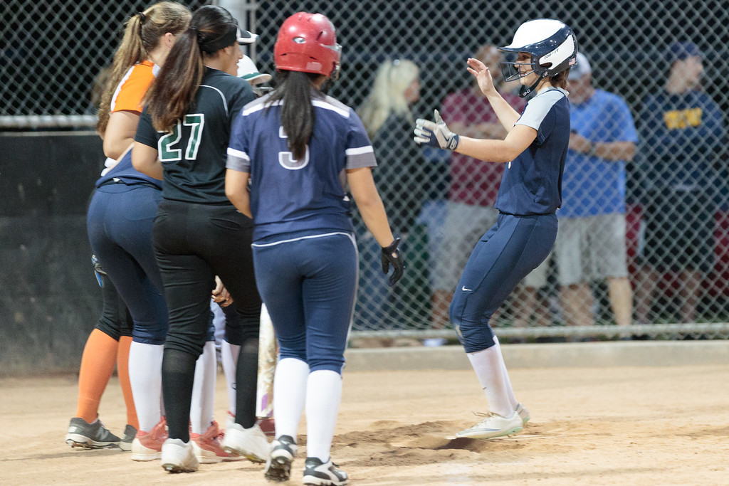 . Private All-Star Team\'s Lauren Veneri is greeted at home plate by her teammates after hitting a home run against the Public All-Star Team in the third inning during the West San Gabriel Valley Prep Softball All Star Game at the Live Oak Park Community Center in Temple City Calif., on Monday June 5, 2017.  Private All-Star Team won 9-5. (Photo by Raul Romero Jr, SCNG)