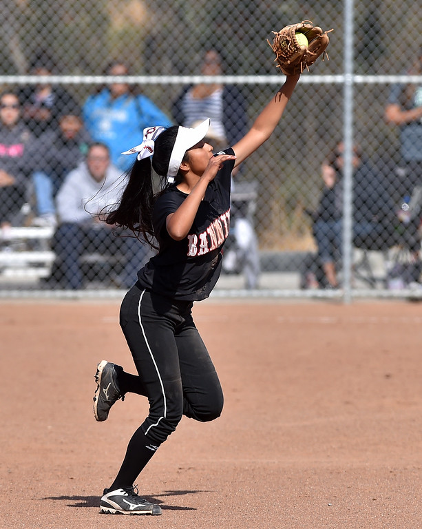 . Banning High defeated POLA 3-1 in Los Angeles City D1 softball semifinal playoff Wednesday May 17, 2017 at Leland Park in San Pedro. Nayely Martinez makes hit saving catch at second base. Photo By  Robert Casillas, Daily Breeze/ SCNG
