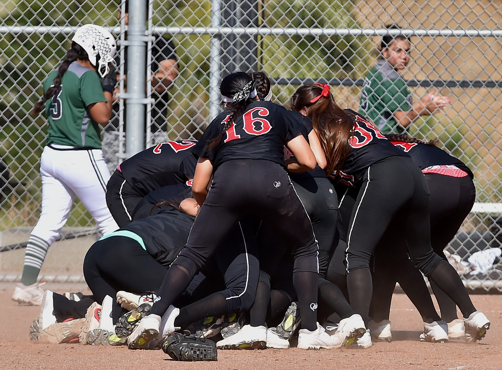. Banning High defeated POLA 3-1 in Los Angeles City D1 softball semifinal playoff Wednesday May 17, 2017 at Leland Park in San Pedro. Banning players pile up after win. Photo By  Robert Casillas, Daily Breeze/ SCNG