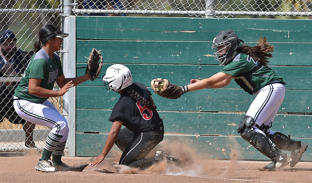 . Banning High defeated POLA 3-1 in Los Angeles City D1 softball semifinal playoff Wednesday May 17, 2017 at Leland Park in San Pedro. Banning\'s Angelina Devoe slides home to score between POLA pitcher Analise De La Roca and catcher Melanie Arent.  Photo By  Robert Casillas, Daily Breeze/ SCNG