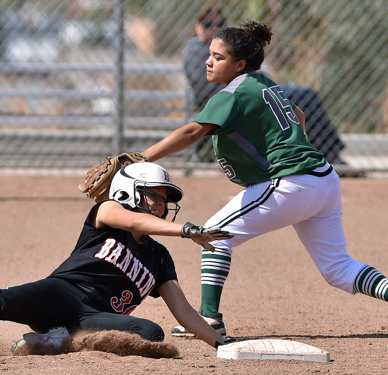 . Banning High defeated POLA 3-1 in Los Angeles City D1 softball semifinal playoff Wednesday May 17, 2017 at Leland Park in San Pedro. Banning\'s Rena Flores slides under tag of POLA SS Robin Grayson. Photo By  Robert Casillas, Daily Breeze/ SCNG