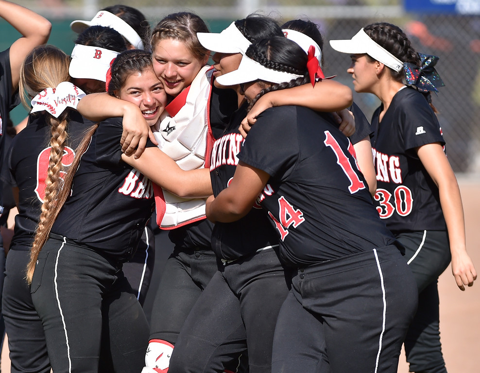 . Banning High defeated POLA 3-1 in Los Angeles City D1 softball semifinal playoff Wednesday May 17, 2017 at Leland Park in San Pedro. Banning players hug after big win sealing trip to LA City final. Photo By  Robert Casillas, Daily Breeze/ SCNG