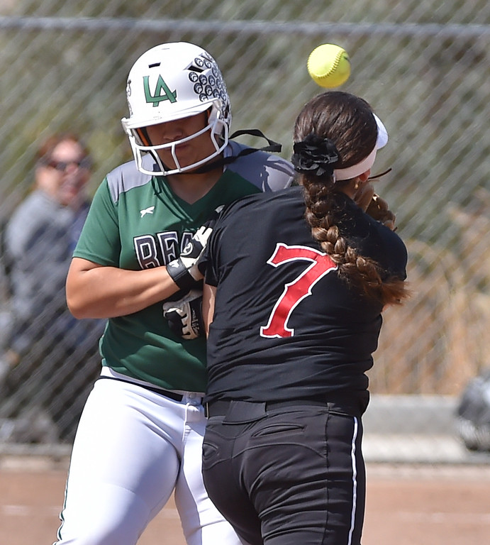 . Banning High defeated POLA 3-1 in Los Angeles City D1 softball semifinal playoff Wednesday May 17, 2017 at Leland Park in San Pedro. POLA base runner Angie Vargas drops a shoulder into Sarahy Martinez attempting to turn DP. Photo By  Robert Casillas, Daily Breeze/ SCNG