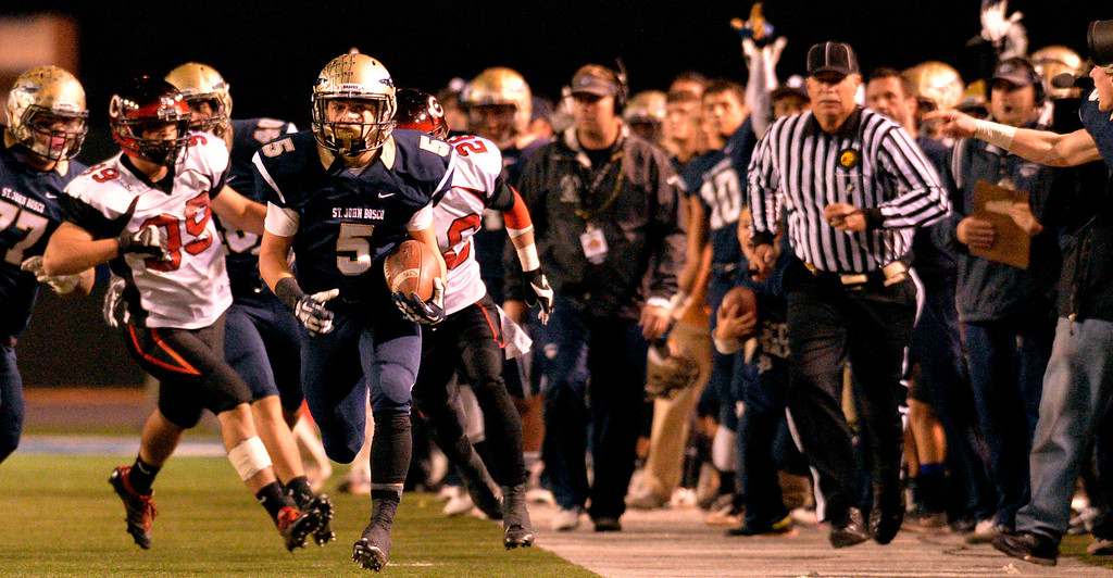 . St. John Bosco\'s Sean McGrew finds a open field as he runs in for a touchdown against Centennial at the CIF Football Regional State Bowl in Norwalk, CA. Saturday December 14, 2013. St. John Bosco went on to win 70-49.