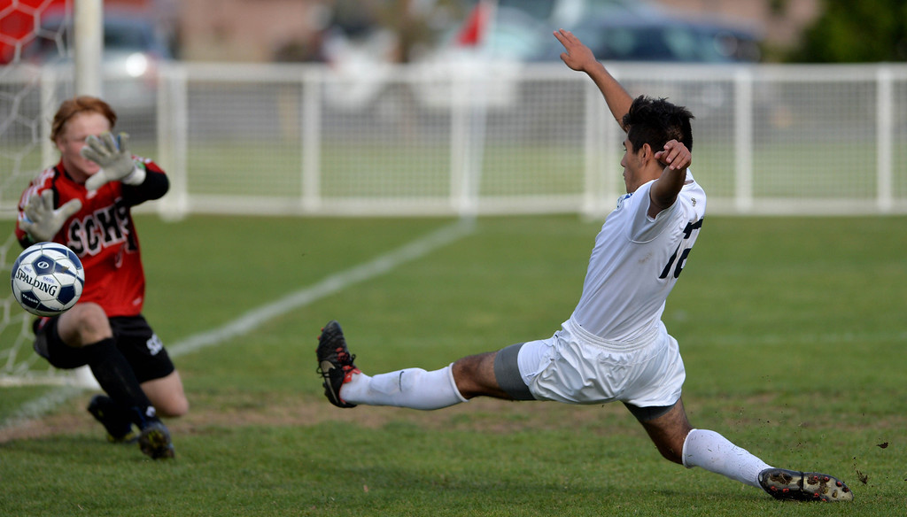 . St. John Bosco\'s Andrew Katnik attempts a goal but it is stopped by Cole Martinez during CIF division 1 boys soccer playoffs. Final score San Clemente 2, St. John Bosco 1.  Bellflower, February 27, 2014. (Photo by Brittany Murray / Press Telegram)