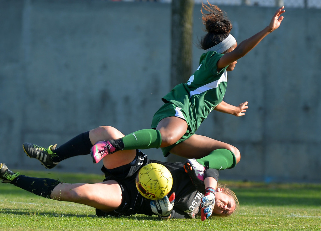 . Poly\'s Lana Hudson and Wilson goalie Samantha Moreno collide after chasing a loose ball in Long Beach, CA on Thursday, February 13, 2014. Long Beach Poly girls soccer beat Wilson 1-0 to capture the Moore League title.  (Photo by Scott Varley, Daily Breeze)