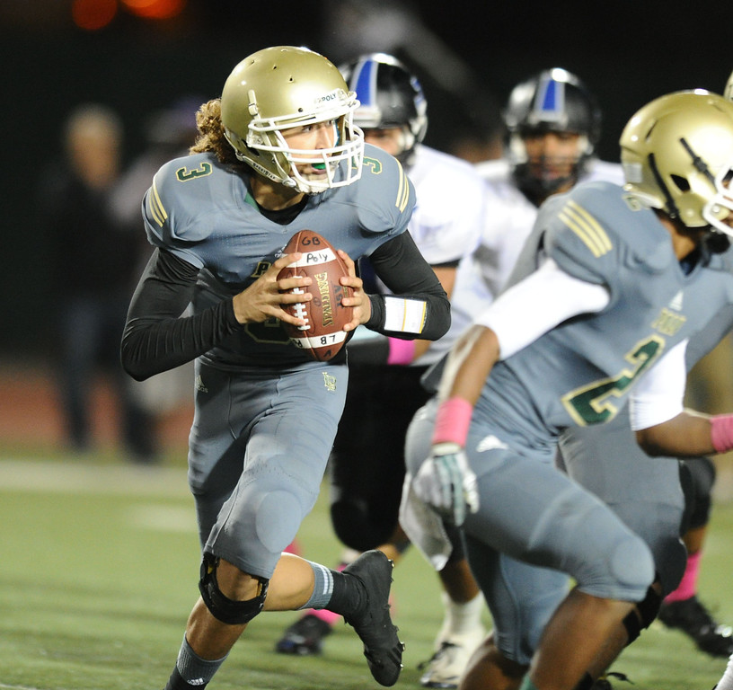 . Poly\'s quarterback Tai Tiedemann looks to pass against Jordan in Friday night\'s Moore League football game at Veterans Stadium in Long Beach, CA. on October 11, 2013. (Photo by Sean Hiller/Press Telegram)