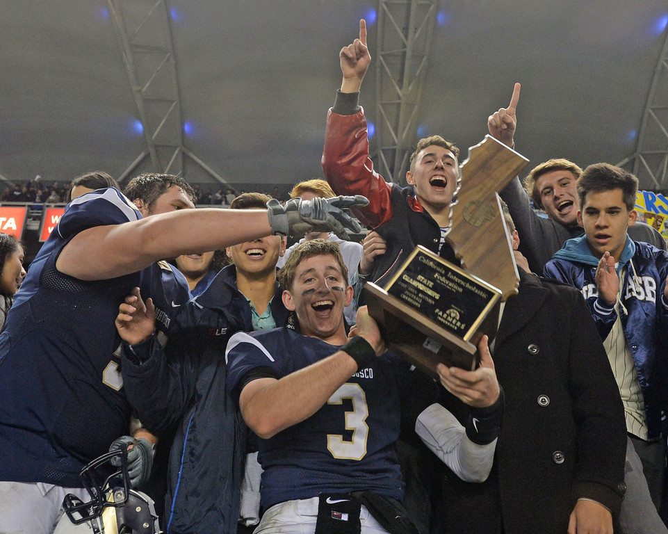 . St. John Bosco\'s Josh Rosen (3) jumps into the stands to celebrate with fans their win against De La Salle in the CIF State Football Bowl Championships Saturday, December 21, 2013, at the Stub Hub Center in Carson, CA.   Bosco won 20-14. Photo by Steve McCrank/DailyBreeze