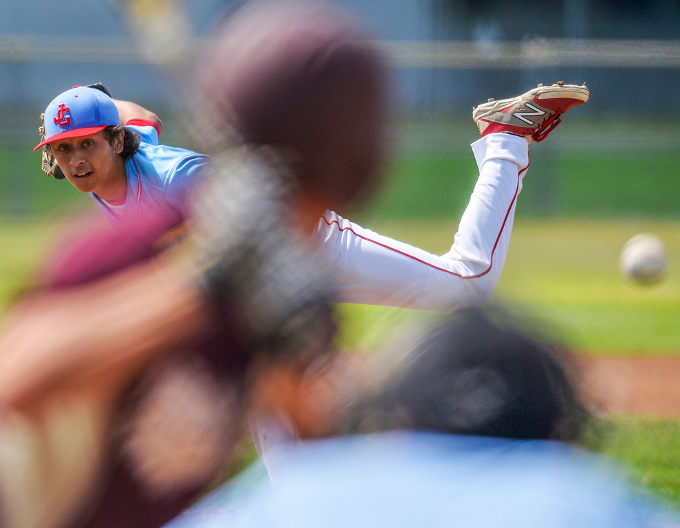. Glenn\'s Victor Sanchez pitches to Bellflower in a Suburban League High School baseball game in Norwalk, CA. Wednesday May 7, 2014.